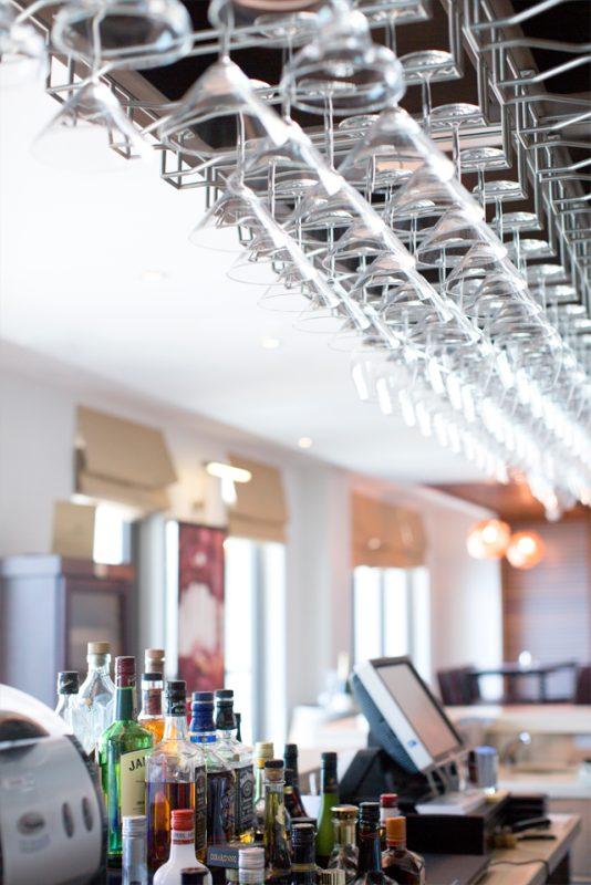 Bar Interior Design - Modern ceiling glass rack over bar