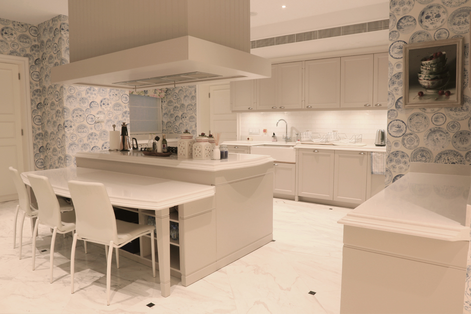 Apartment Kitchen Design - Blue & white China porcelain style walls, cabinets with white granite tops & modern cooking island