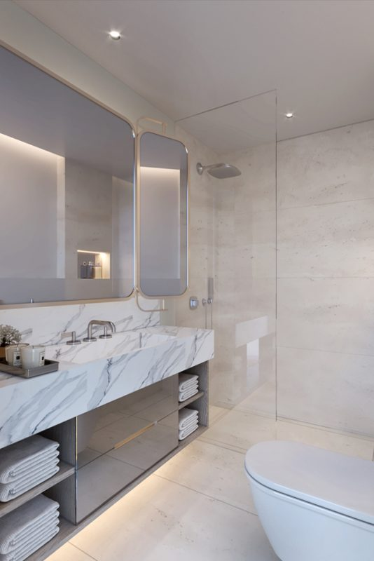 Interior Bathroom Design - Modern bathroom with rounded corner mirrors, marble walls & counter tops with silver storage unit