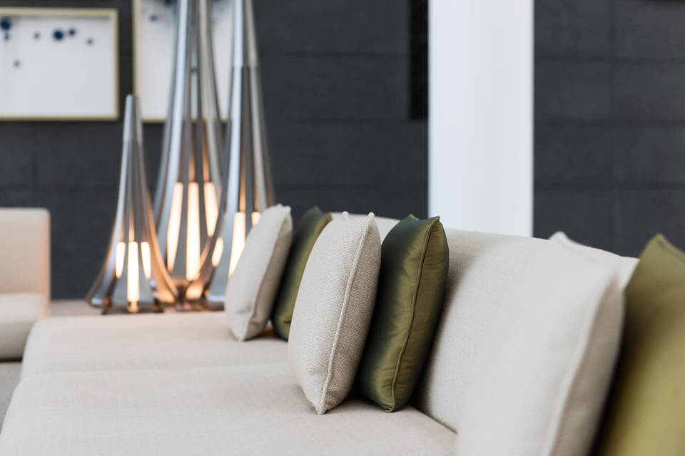 Interior Decorating - Teepee shaped silver lamps behind luxury couch and cushions