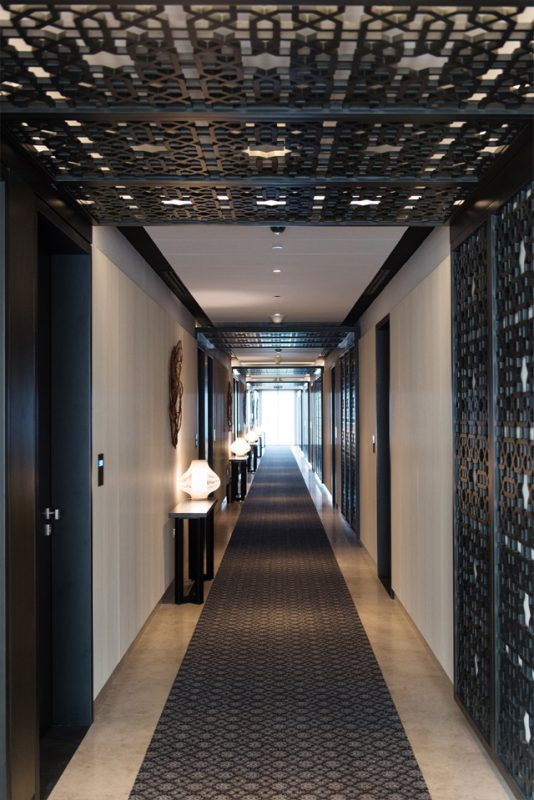 Hotel Passage Design - Passage entrance with Molded GRP-paneled wall & ceiling feature & runner on marble floor