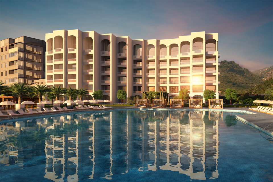 Hotel Design by Cecilia Clason Interiors - Hotel building overlooking large pool with sunbeds, umbrellas & palm trees