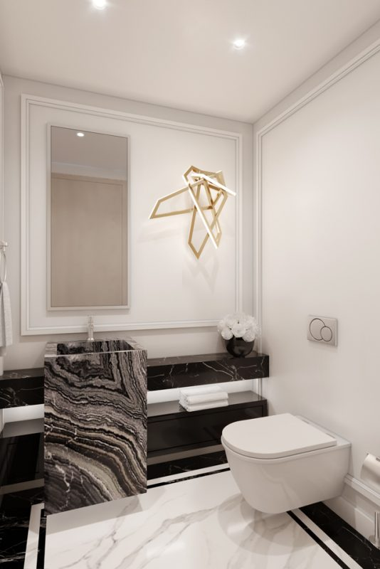 Modern Bathroom Interior - Textured marble sink & counter on black & white marble floor, & a gold lighting feature on wall
