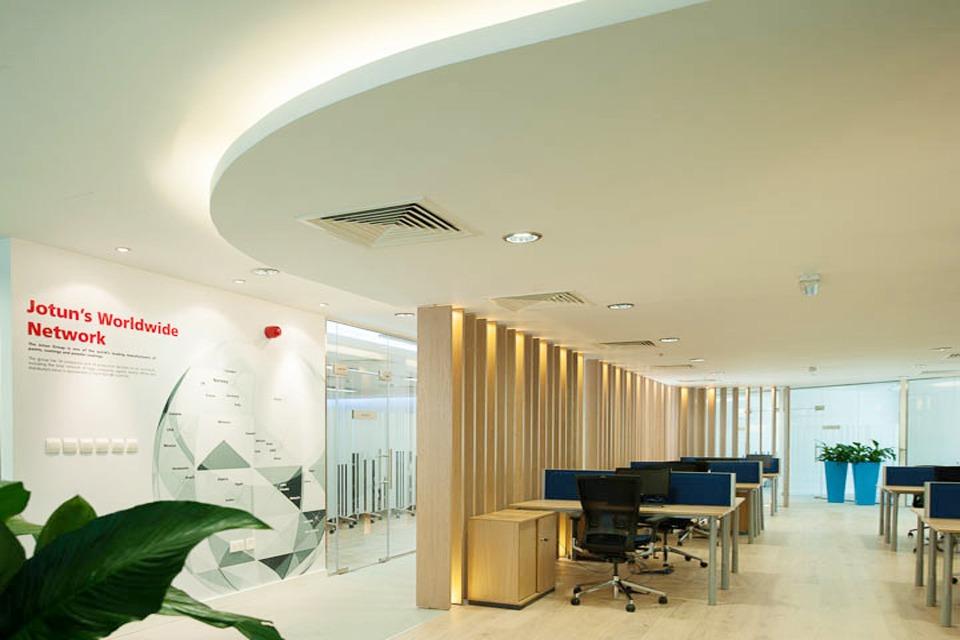 Office Design - Modern ceiling with light wooden Concertina room divider. Office chairs, wood top desks & blue desk dividers