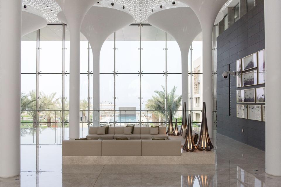 Hotel Interior Design - Molded GRP-paneled ceiling, illuminated columns, light marble floor & large glass windowpanes