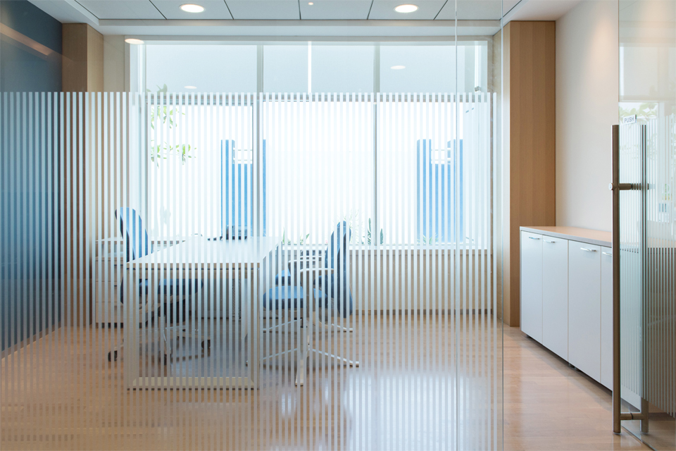 Office Interior Designer - Striped frosted glass behind office