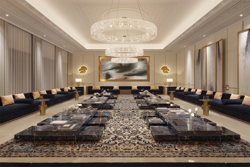 Majlis Design - Marble tables on large Persian rug, surrounded by navy sofas, gold side tables & under a modern chandelier